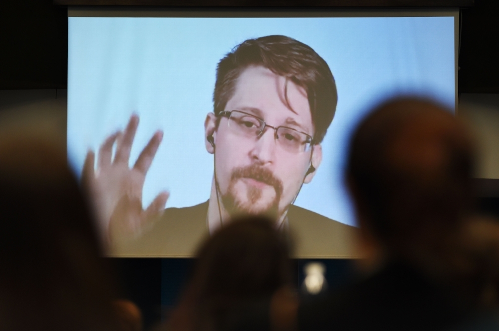 Former US National Security Agency (NSA) contractor and whistle blower Edward Snowden speaks via video link from Russia as he takes part in a round table meeting on the subject of