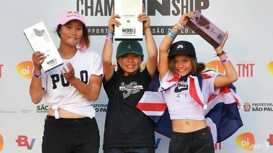 Misugu Okamoto (C), Sakura Yosozumi (L) and Sky Brown celebrate on the medal podium at the World Park Skateboarding Championships in Sao Paulo, Brazil, in this Sept. 14, 2019 file photo. — AFP