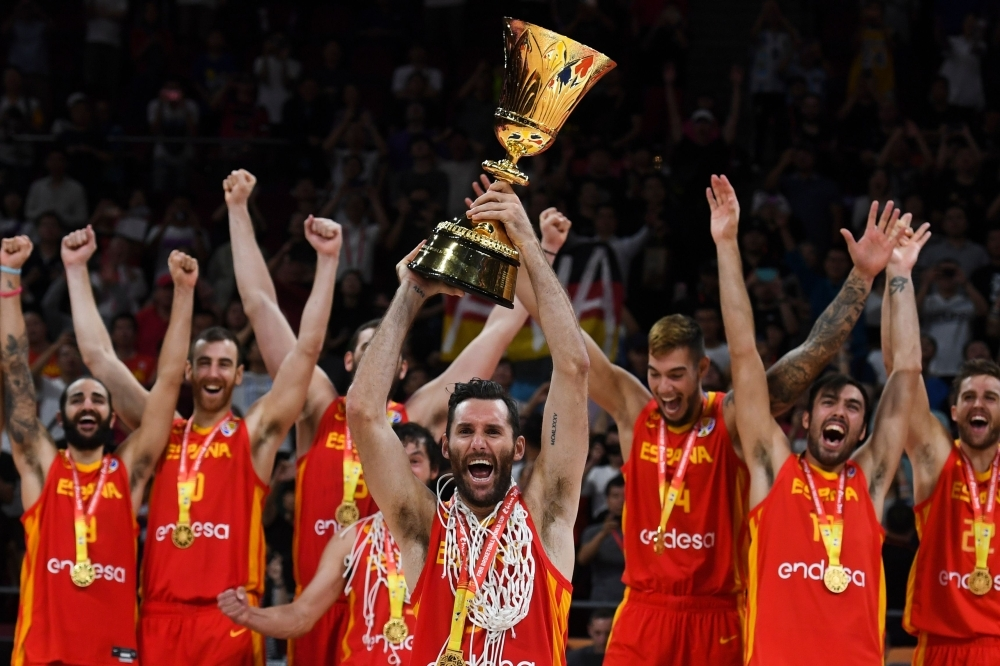 Spain's players celebrate with their winning trophy at the end of the Basketball World Cup final game between Argentina and Spain in Beijing, on Sunday. — AFP