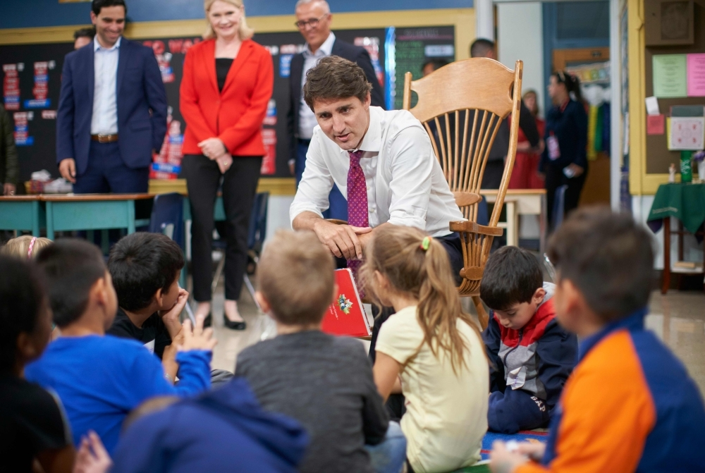 Canadian Prime Minister Justin Trudeau reads a story to Grade 1 and 2 students at a campaign stop at Blessed Sacrament Catholic Elementary School in London, Ontario on Monday. Polls showed Trudeau, once the youthful golden boy of Canadian politics, in a horse race with Conservative Andrew Scheer, who launched his bid for leadership by accusing the Liberal prime minister of lying