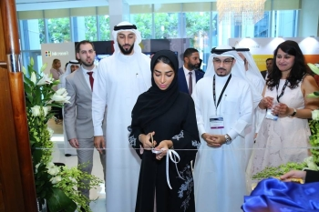 Sheikha Maryam Al Qasimi, Government Relations and Protocol Specialist for Lead Ventures, cuts the ceremonial ribbon
