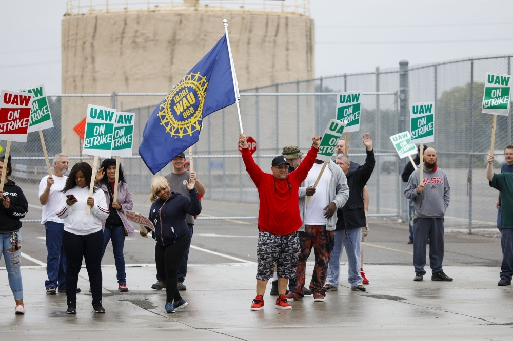 United Auto Workers (UAW) members picket at a gate at the General Motors Flint Assembly Plant after the UAW declared a national strike against GM on Monday in Flint, Michigan. -AFP