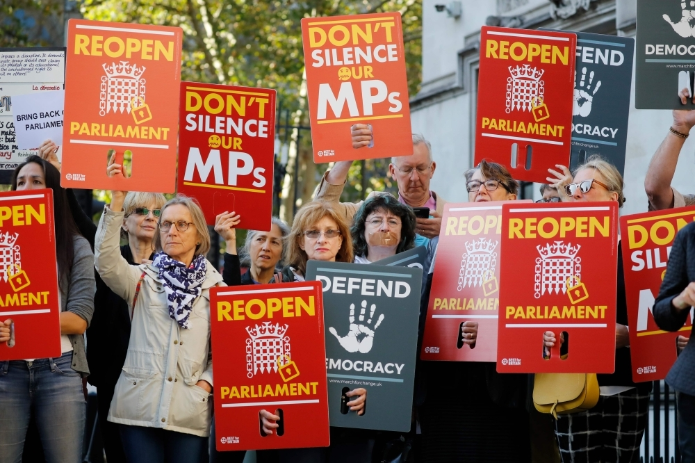 Demonstrators protest outside the Supreme Court in central London on Tuesday, the first day of the hearing into the decision by the government to prorogue parliament. -AFP