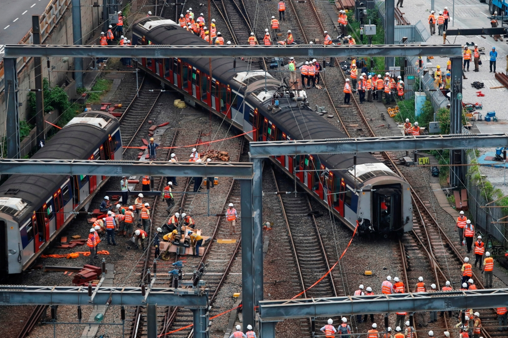 A Mass Transit Railway (MTR) train is seen derailed on the East Rail line in Hong Kong on Tuesday. -Reuters
