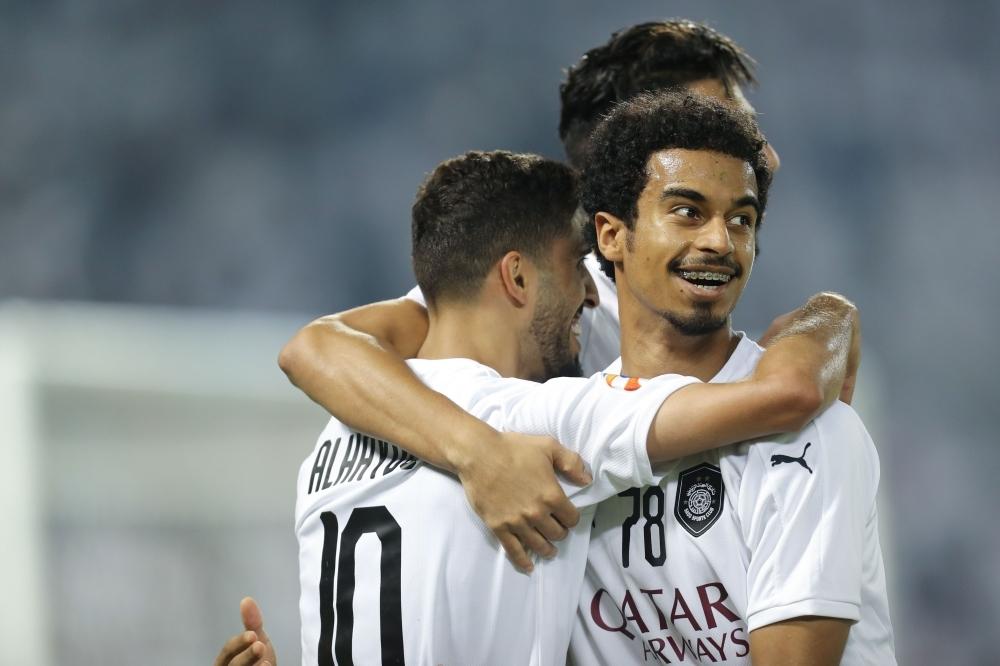Sadd SC's Qatari midfielder Hassan Al-Haidos (L) celebrates with Al-Sadd's Qatari forward Akram Afif (R) during the AFC Champions League quarterfinal football match between Saudi Arabia's Al-Nassr and Qatar's Al-Sadd at the Jassim Bin Hamad Stadium in Doha, on Monday. — AFP