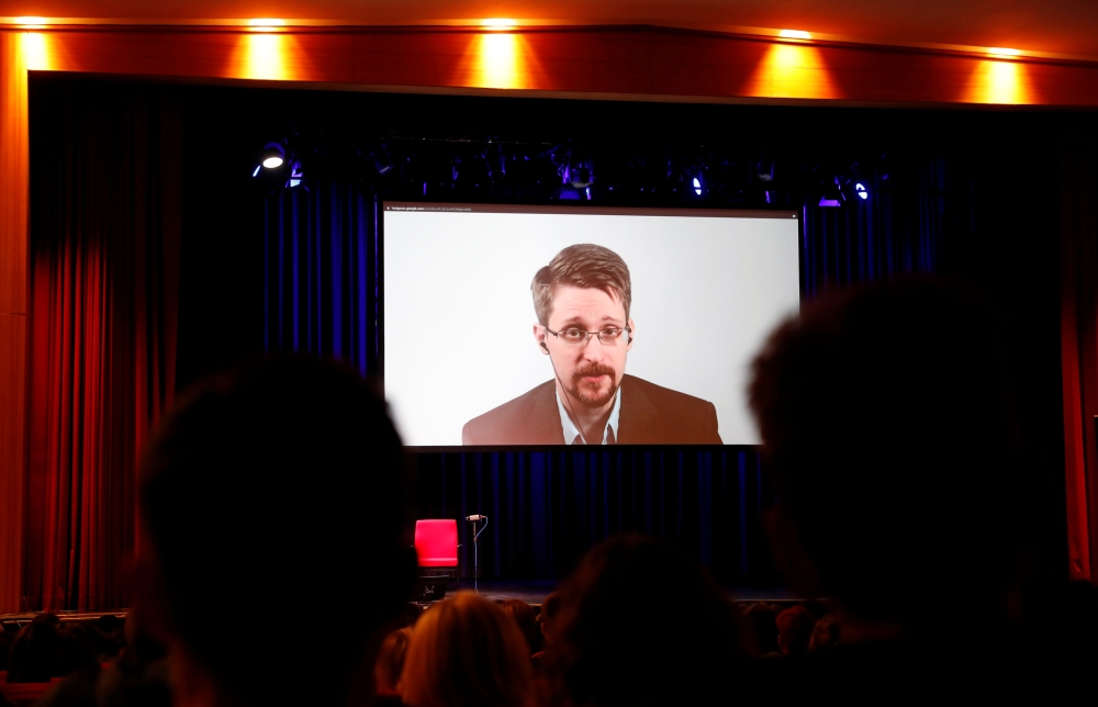 Edward Snowden speaks via video link as he takes part in a discussion about his book