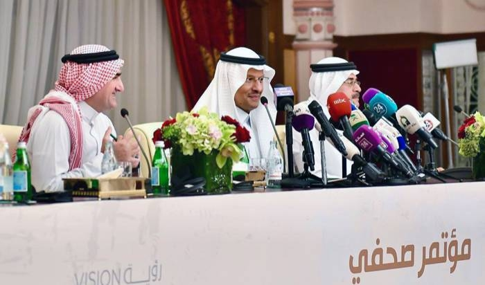 Energy Minister Prince Abdulaziz Bin Salman, center, with Aramco Chairman Yasir Al-Rumayyan, left, and CEO Amin Nasser speak during the press conference at Ritz Carlton in Jeddah on Tuesday.
