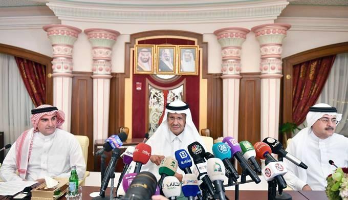 Energy Minister Prince Abdulaziz Bin Salman, center, with Aramco Chairman Yasir Al-Rumayyan, left, and CEO Amin Nasser speak during the press conference at Ritz Carlton in Jeddah on Tuesday.