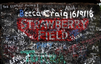 Graffiti is pictured on the gates to Strawberry Field in Liverpool, northwest England on Wednesday. Beatles fans can now take a trip through the childhood sanctuary of John Lennon that inspired seminal song