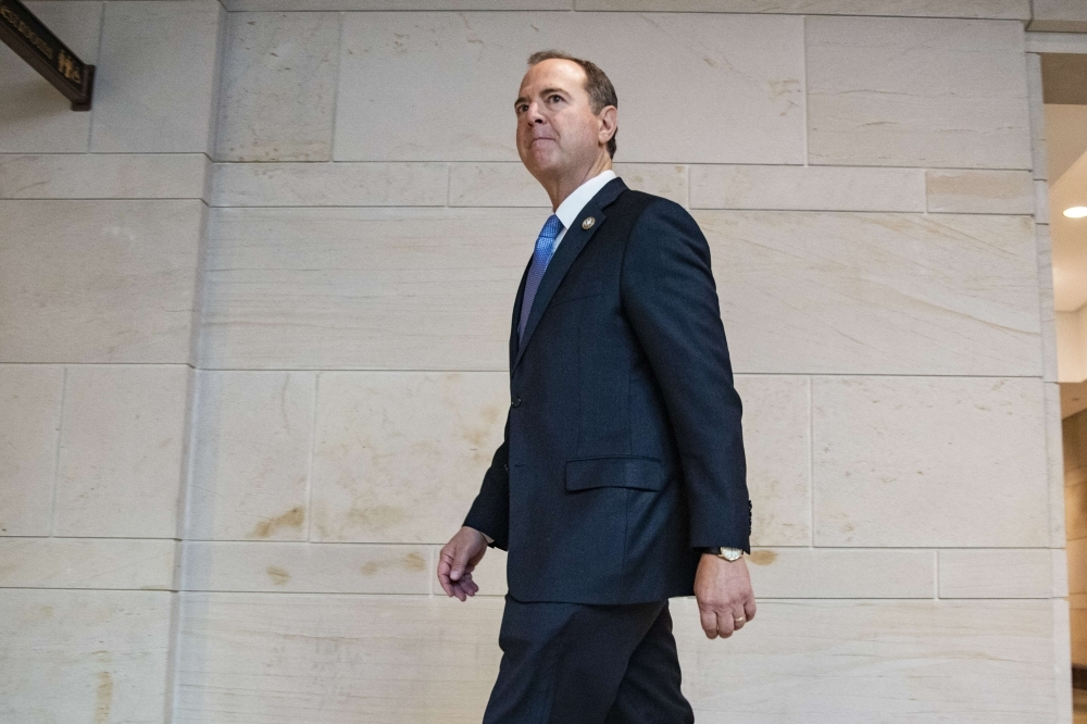 Permanent Select Committee on Intelligence Chairman Adam Schiff (D-CA) arrives at the Capitol before the committee meeting with Acting Director of National Intelligence Joseph Maguire on Thursday in Washington, DC. Acting Director Maguire is set to meet with members of the House Intelligence Committee over a recent whistleblower complaint against President Donald Trump by an intel analyst.  — AFP