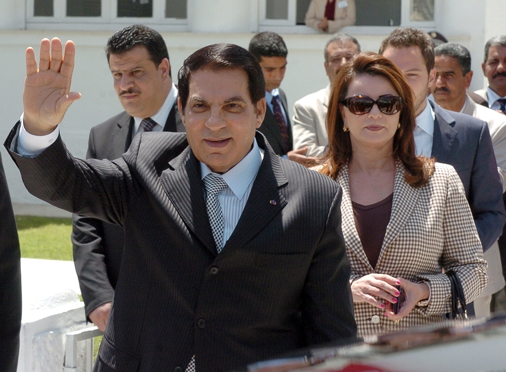 In this file photo taken on May 9, 2010, former Tunisian President Zine El Abidine Ben Ali (front) waves to wellwishers after voting for the municipal elections next to his wife Leila (C) and his son-in-law the Tunisian businessman Sakhr Materi (R). Tunisia's all-powerful leader for two decades died Thursday aged 83, Tunisia's Foreign Ministry said. — AFP