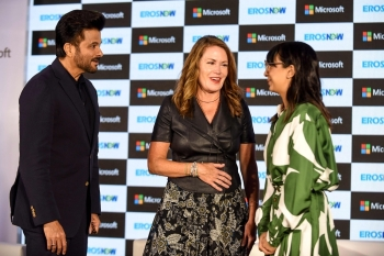 Bollywood actor Anil Kapoor (L), Executive Vice President of Business Development at Microsoft Corp Peggy Johnson (C) and CEO at Eros Digital Rishika Lulla Singh (R) interact during the launch of new streaming service 'Eros Now' in collaboration with Microsoft in Mumbai on Wednesday. — AFP