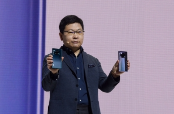 Richard Yu (Yu Chengdong), head of Huawei's consumer business Group, speaks on stage during a presentation to reveal Huawei's latest smartphones