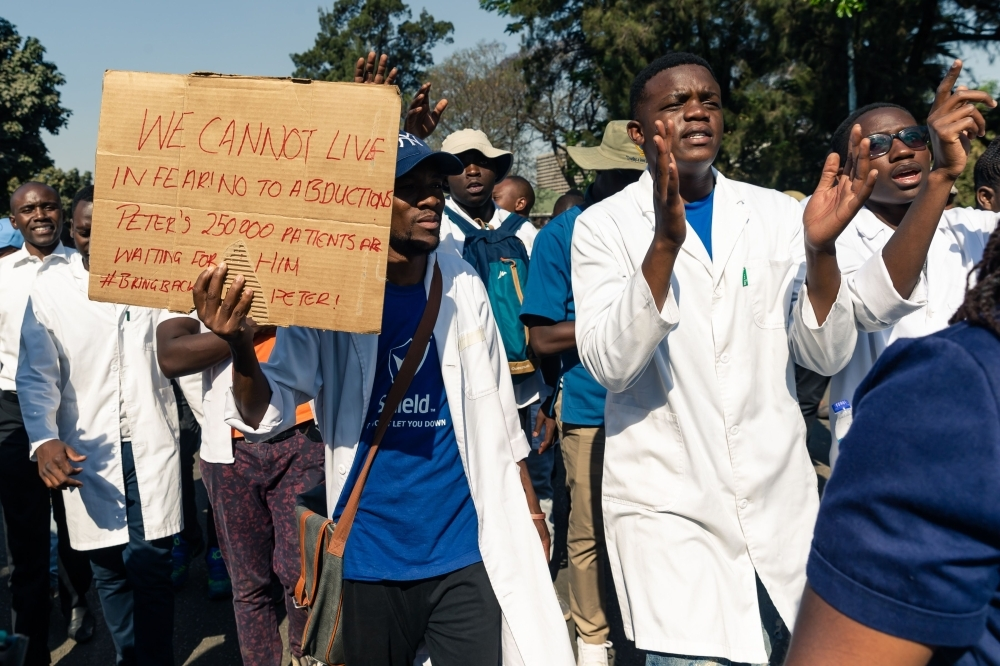 Doctors and medical staff march to Zimbabwe's Parliament on September 19, 2019 in Harare with a petition demanding the safe return of Peter Magombeyi, a doctors' union leader who has been missing since September 14 at night, after he sent a WhatsApp message saying he had been