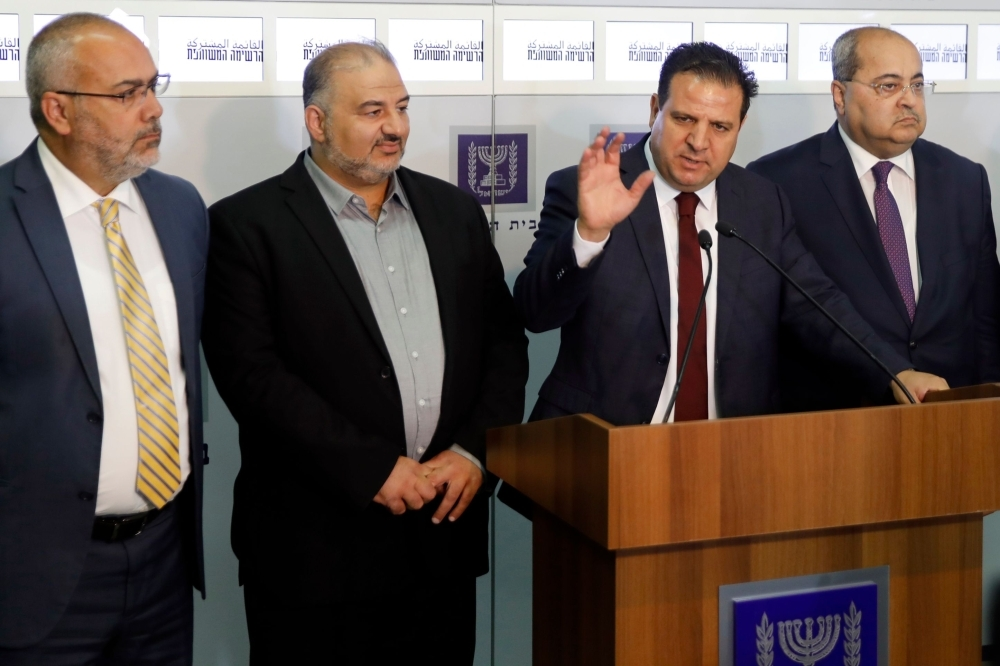Members of the Joint List Ayman Odeh (C) speaks to the press in the presence of Ahmad Tibi (R), Osama Saadi (L) and Mansour Abbas (2nd-L) following their consulting meeting with Israeli President, to decide who to task with trying to form a new government, in Jerusalem on Sunday. — AFP