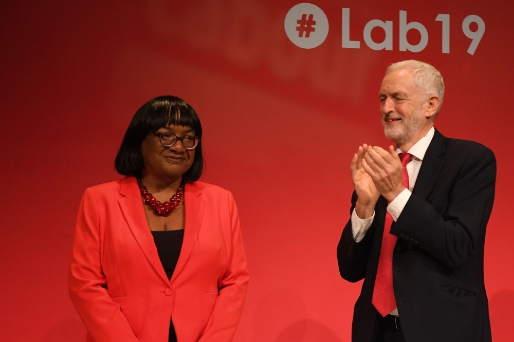 Britain's main opposition Labour Party leader Jeremy Corbyn (R) applauds shadow home secretary Diane Abbott (L) after her speech at the Labour party conference in Brighton, on the south coast of England on Sunday. Britain's main opposition Labour Party begins its annual conference on Sunday desperately searching for a coherent Brexit plan to stem a potential drubbing in a looming election. — AFP