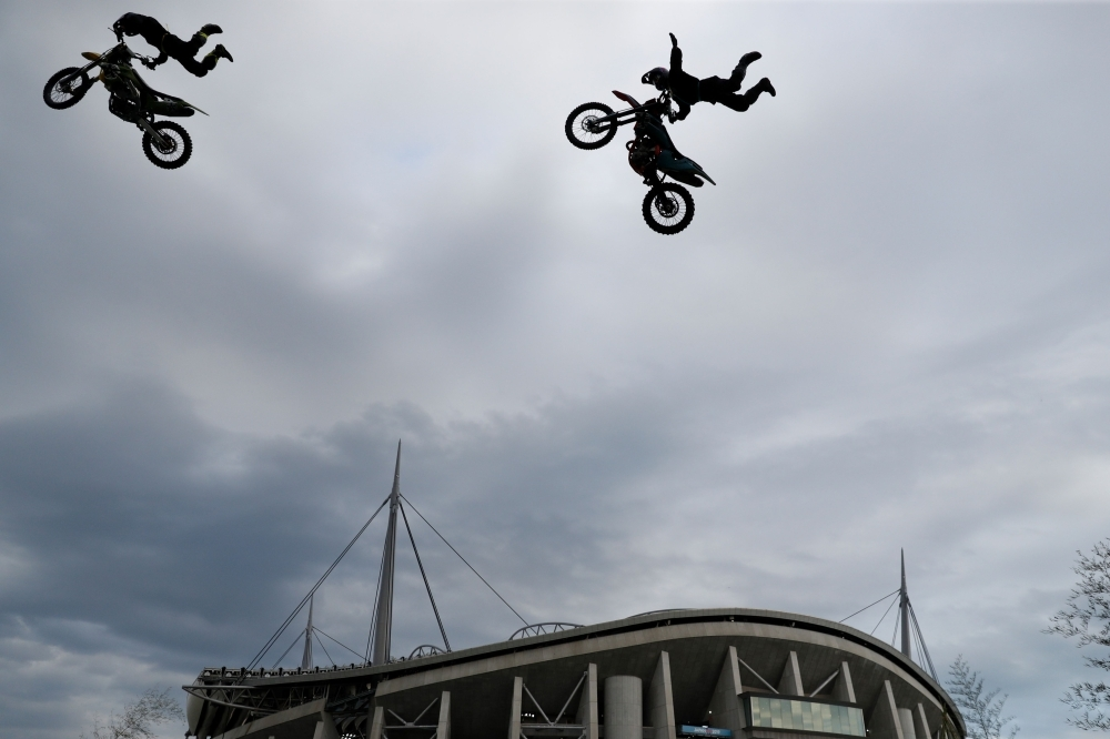 Motorcycle acrobats perform outside the City of Toyota Stadium in Toyota City ahead of the Japan 2019 Rugby World Cup Pool D match between Wales and Georgia on Monday. — AFP