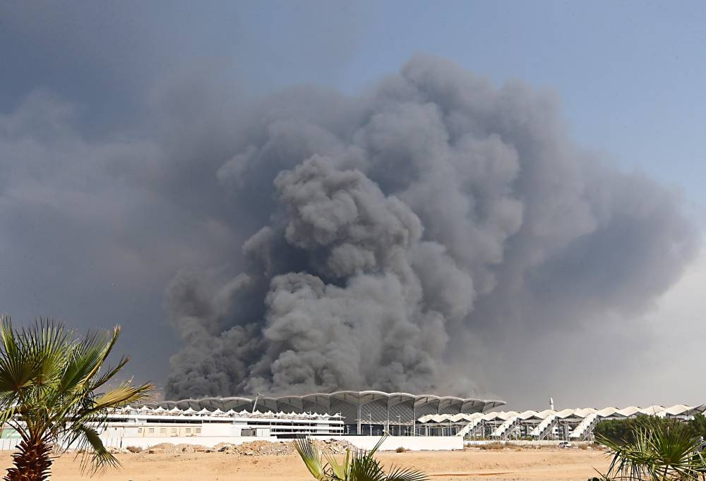 The Civil Defense forces, with the support of helicopters, battled for long hours to put out the fire that engulfed the roof of the Haramain High Speed Rail station in Sulaymaniyah district in Jeddah on Sunday. — Okaz/SG photo by Amr Sallam