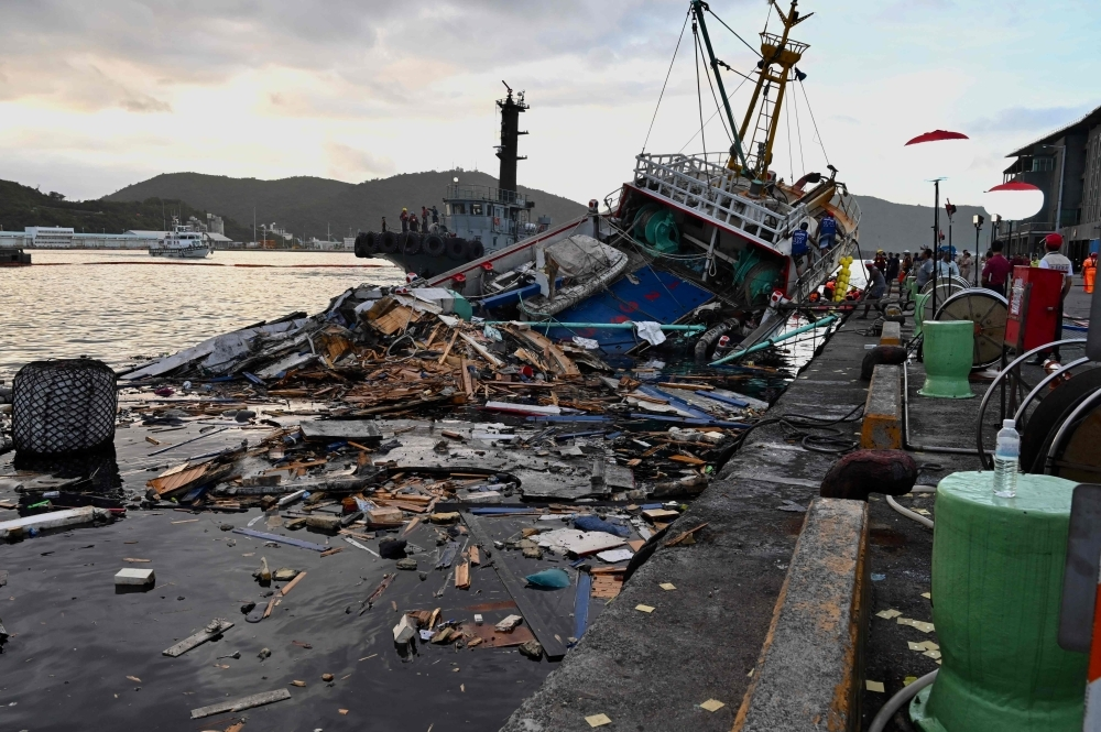 This picture taken on Tuesday shows the wreckage of a fishing boat after a bridge collapsed in the Nanfangao fish harbor in Suao township in Ilan county, eastern Taiwan.   — AFP