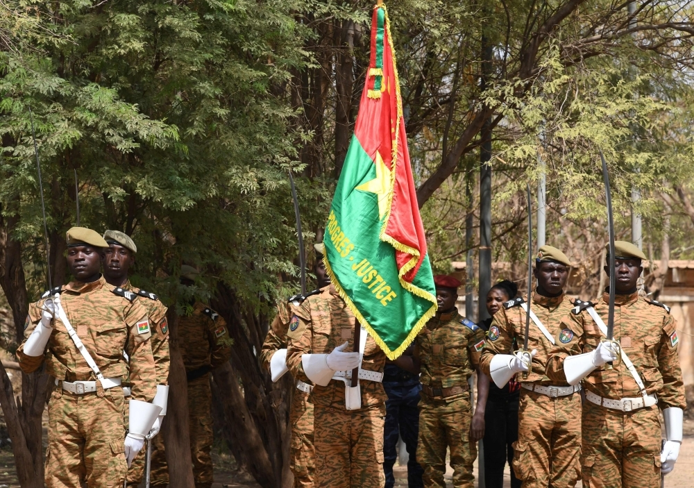 In this file photo taken on March 2, 2019 Burkinabe soldiers take part in a ceremony in Ouagadougou. -AFP
