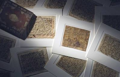 Group of large Kufic Qur'an leaves.
