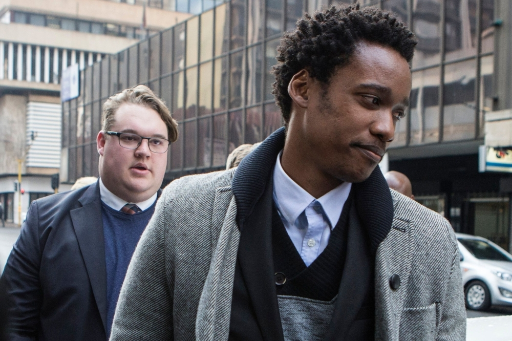 Duduzane Zuma, right, son of former South African president Jacob Zuma, leaves the court where he faced corruption charges before being released on bail in Johannesburg in this July 9, 2018 file photo. — AFP
