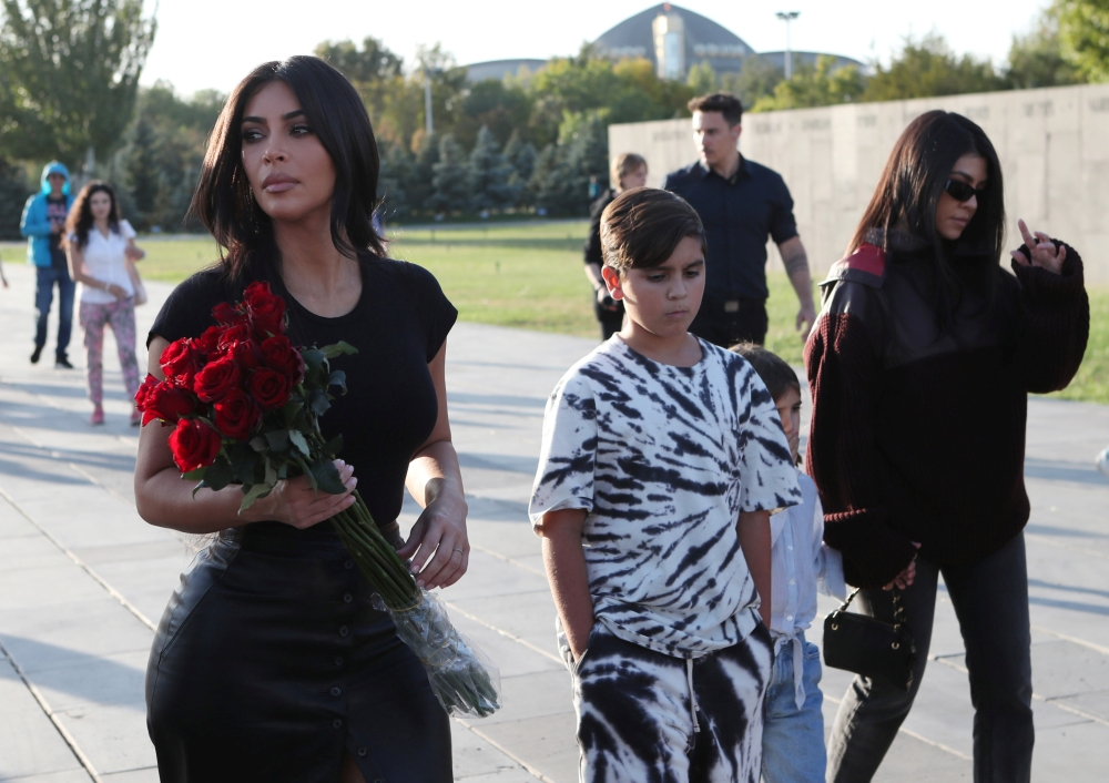 Reality TV personality Kim Kardashian, right, and her sister Kourtney Kardashian, left, with children visit Armenian Genocide Memorial in Yerevan, Armenia, on Tuesday. — Reuters