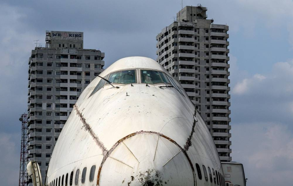 An abandoned aircraft is seen in the suburbs of Bangkok on October 9, 2019. The area, known as the