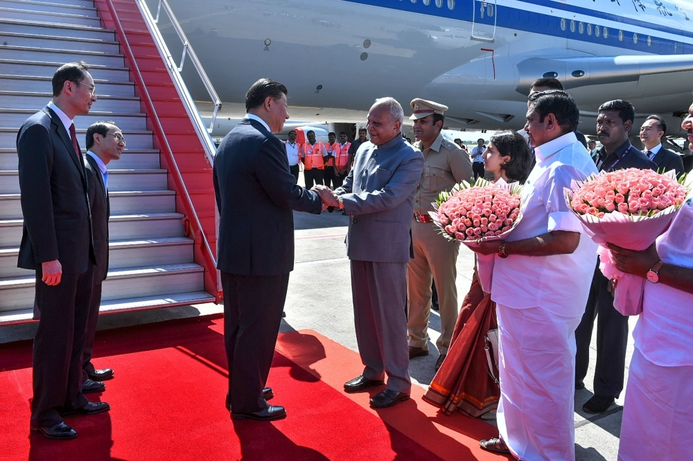 In this handout photograph taken and released by Indian Ministry of External Affairs (MEA) on Friday, China's President Xi Jinping (3L) arrives in Chennai, to attend a summit with India's Prime Minister Narendra Modi at the World Heritage Site of Mahabalipuram in Tamil Nadu state.  — AFP