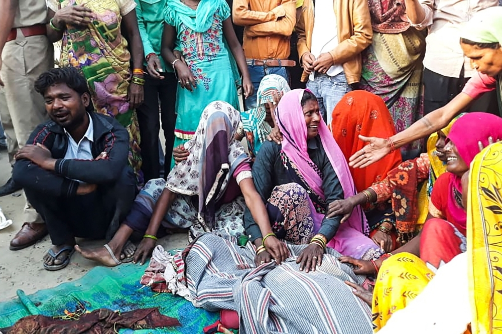 Relatives mourn over the bodies of the victims of a bus accident in Bulandshahr district of Uttar Pradesh state. A bus mowed down and killed four women and three children on Friday, who were sleeping by a roadside in northern India and were going to make a ritual dip in the holy Ganges river, police said. — AFP