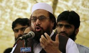 Pakistani authorities on Thursday arrested four aides of Islamist leader Hafiz Saeed, seen in this file photo, on terrorism financing charges, counter-terrorism police said.