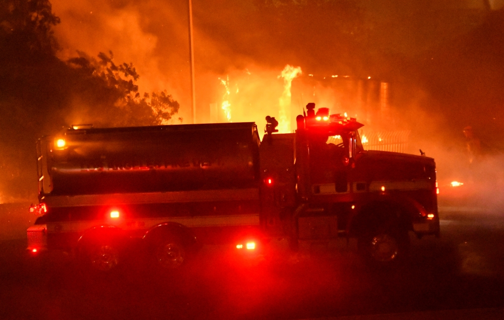 Los Angeles County fire tender is seen during wind-driven wildfire fire in Sylmar, California, on Thursday. — Reuters