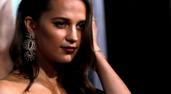 Cast member Alicia Vikander poses at the premiere for