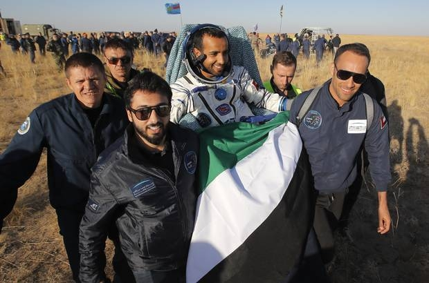 Russian space agency rescue team members and United Arab Emirates specialists carry United Arab Emirates astronaut Hazzaa Ali Al-Mansoori shortly after the landing. –Courtesy photo