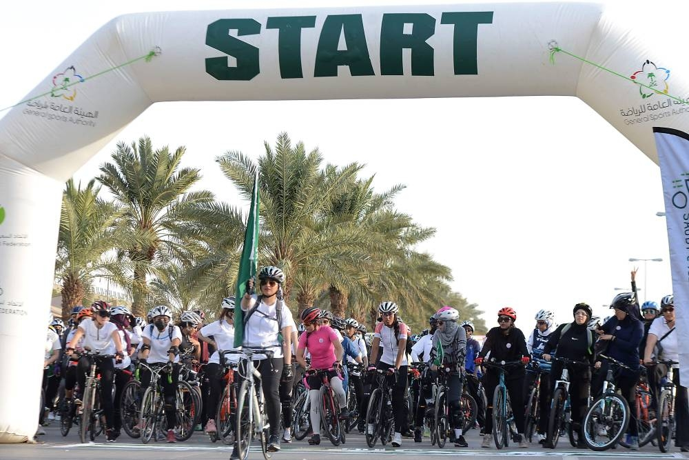 Women take part in a cycling race to mark World Obesity Day celebration in Riyadh's Princess Noura University, Friday. — AFP