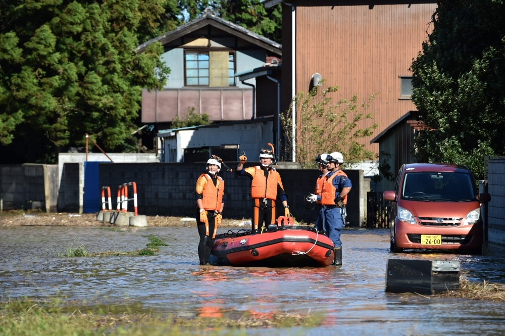Rescue personnel work in a flooded area in the aftermath of Typhoon Hagibis in Kawagoe city, Saitama prefecture on Sunday. -AFP