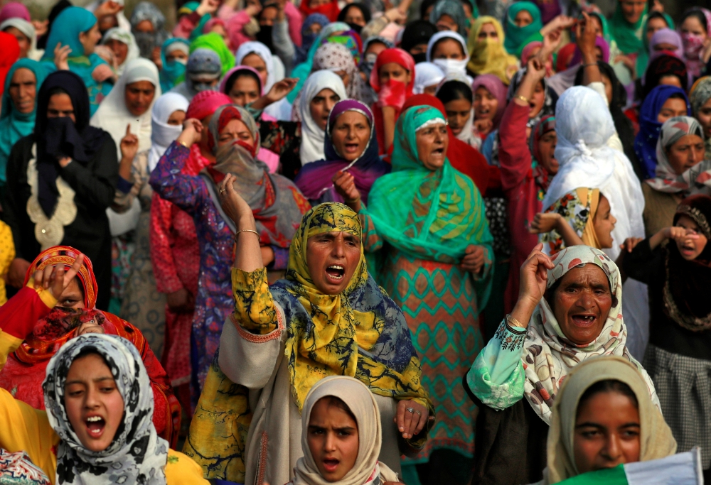 Kashmiri women and girls shout slogans as they attend a protest after Friday prayers during restrictions following the scrapping of the special constitutional status for Kashmir by the Indian government, in Srinagar, October 11, 2019. -Reuters