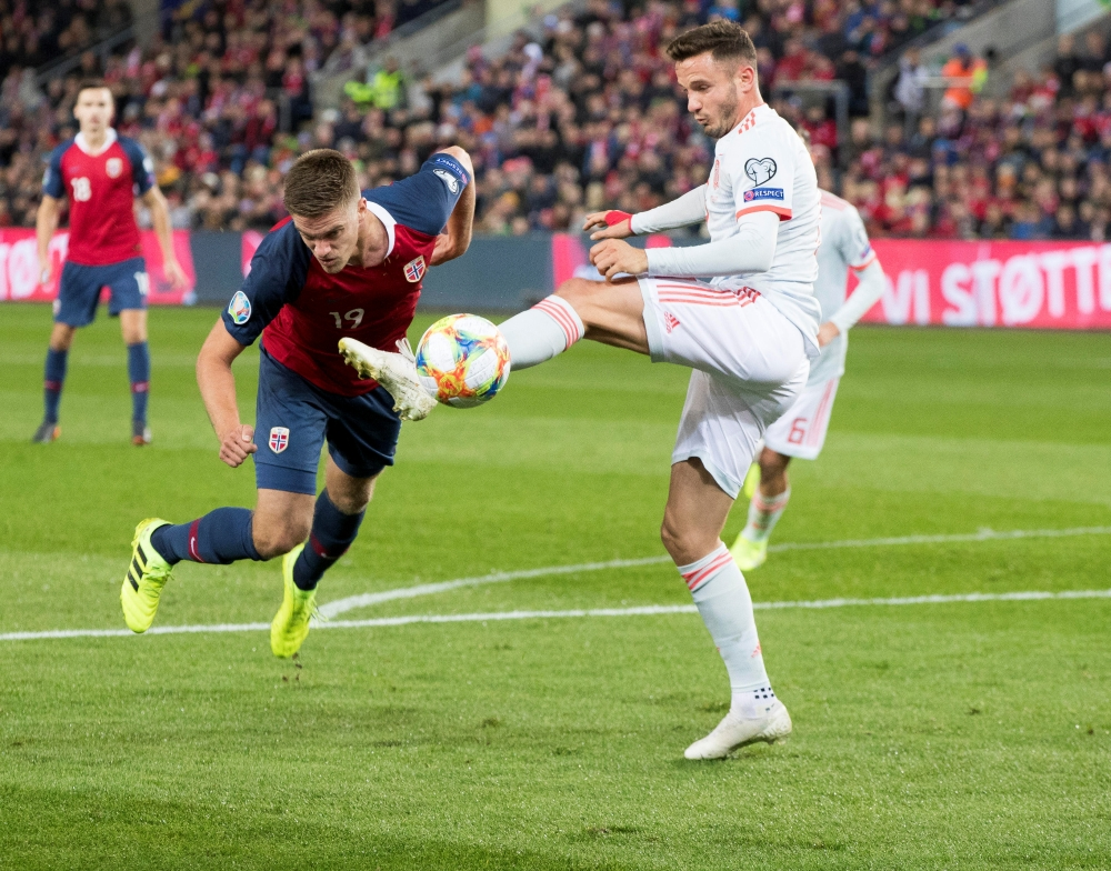 Spain's Saul Niguez fights for the ball against Norway's Markus Henriksen during Euro 2020 Qualifier Group F at Ullevaal Stadium, Oslo, Norway, on Saturday. — Reuters