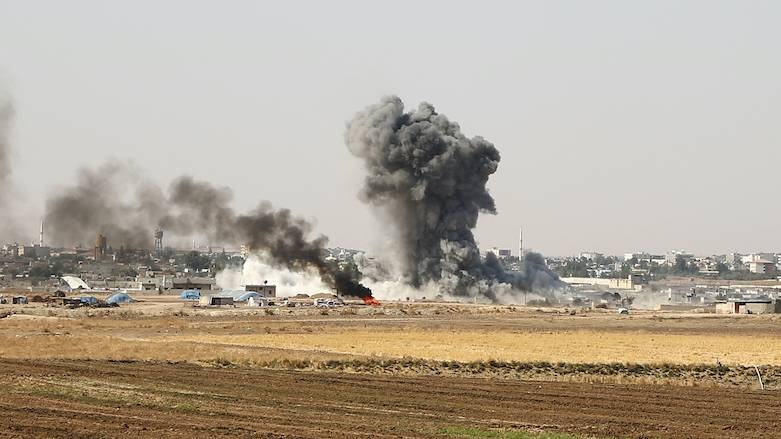 Smoke billows from the Syrian border town of Ras Al-Ain on Saturday as Turkey and its allies continued their assault on Kurdish-held border towns in northeastern Syria. -AFP