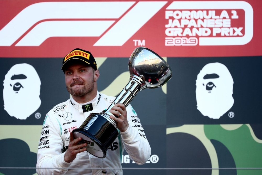 Mercedes' Finnish driver Valtteri Bottas celebrates his victory on the podium at the end of the Formula One Japanese Grand Prix final at Suzuka, on Sunday. — AFP