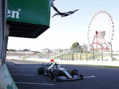 Mercedes driver Valtteri Bottas gets the checkered flag while crossing the finish line to win the Japanese Grand Prix. — Courtesy photo
