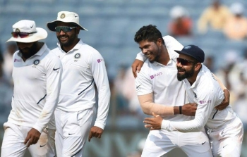 Indian players celebrate the wicket of South African Vernon Philander en route to victory in the second Test in Pune, on Sunday. — AFP