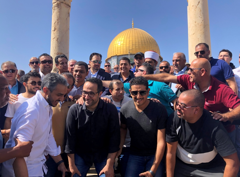 Saudi Arabia's national soccer team members pose in front of the Dome of the Rock in Jerusalem, on Monday. — Reuters