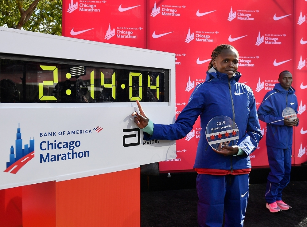 Brigid Kosgei of Kenya poses for a photo after breaking the world record to win the 2019 Bank of America Chicago Marathon in Chicago, Illinois, on Sunday. — AFP