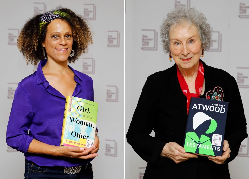 A combination of pictures created on Tuesday shows British author Bernardine Evaristo, left, posing with her book 'Girl, Woman, Other' and Canadian author Margaret Atwood poses with her book 'The Testaments' during the photo call for the authors shortlisted for the 2019 Booker Prize for Fiction at Southbank Centre in London on Oct. 13, 2019. — AFP