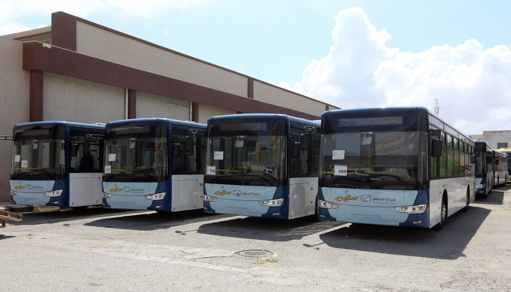Parked in a hangar in downtown Tripoli on Sept. 3, 2019 , some 35 buses await the launch of a new urban public transport scheme — the first in the Libyan capital in three decades. — AFP