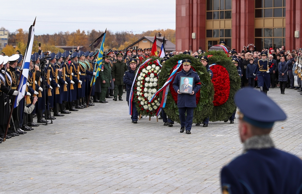 Officers carry a coffin of Alexei Leonov, the first man to conduct a space walk in 1965, during his funeral in Mytishchi, outside Moscow, Russia, on Tuesday. — Reuters