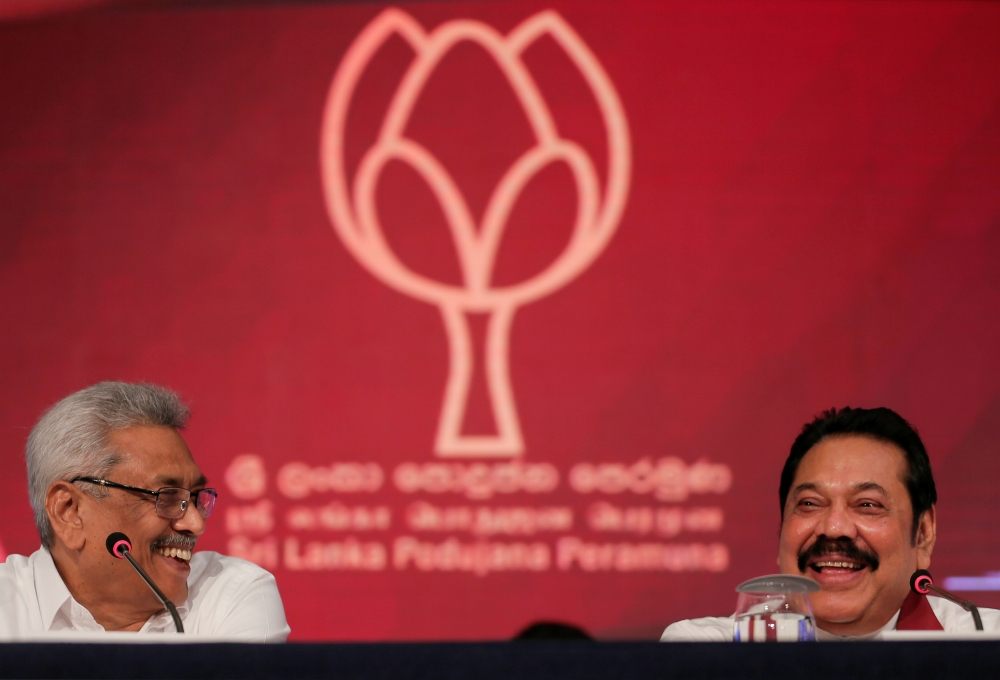 Gotabhaya Rajapaksa, left, Sri Lanka People's Front party presidential election candidate and former wartime defence chief and his brother and former president, Mahinda Rajapaksa attend a news conference in Colombo, Sri Lanka, on Tuesday. — Reuters