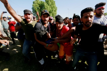 Men carry an injured demonstrator at a protest during a curfew, three days after the nationwide anti-government protests turned violent, in Baghdad, in this Oct. 4, 2019 file photo. — Reuters