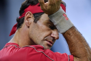 Roger Federer of Switzerland gestures while playing against Alexander Zverev of Germany during their men's singles quarter-final match at the Shanghai Masters tennis tournament in Shanghai in this Oct. 11, 2019 file photo. — AFP